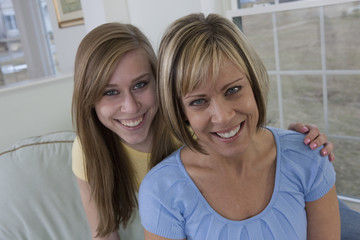 Smiling portrait of a mother and teenage daughter