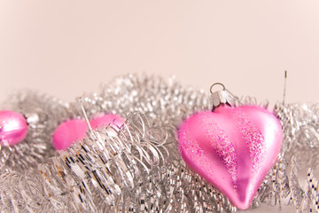 pink christmas decoration with silver garland