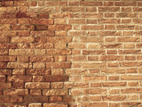Uneven and old brick wall background poster