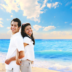 Colorful portrait of couple by the beach