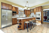 Fototapety Kitchen with oak cabinetry