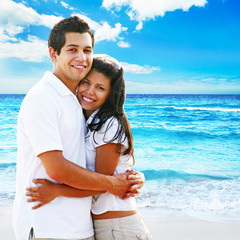 Couple embracing at the beach