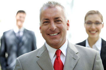 Happy mature businessman