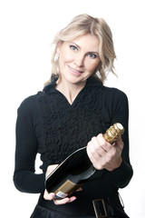 Beautiful woman with an bottle of champagne
