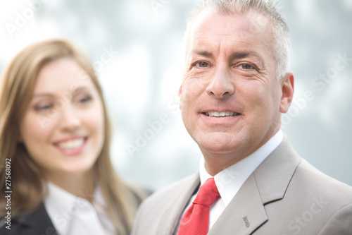 Businessman with assistant in the background
