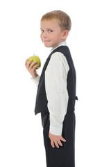 boy holds an apple