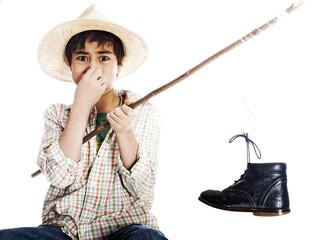 boy fishing catching a shoe