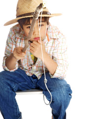 child fishing quietly concentrating