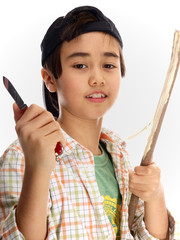 child peeling off the bark of a twig