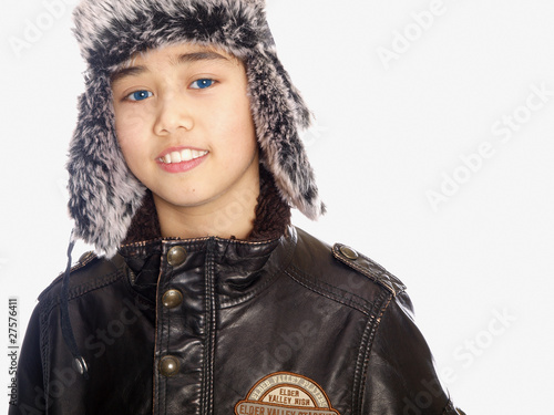 boy wearing a russian hat isolated on white background