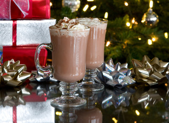 christmas relaxation - two cups of hot chocolate with holiday ba