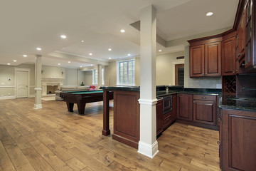 Basement with fireplace and bar