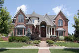 Luxury home with turret and arched entry poster