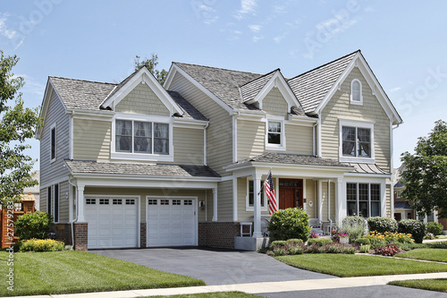 Suburban home with front porch - 27579283