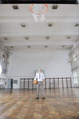 businessman holding basketball ball