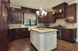 Kitchen with white and granite island