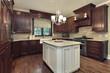 Kitchen with white and granite island
