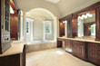Master bath with white tub columns