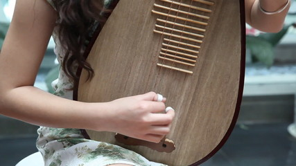 Chinese girl playing the national instrument - pipa