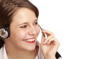 Call Center Telefonistin telefoniert freudlich mit Headset