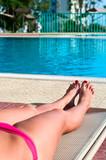 Legs of beautiful young unrecognizable girl in a bikini poster