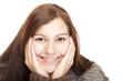 Gesunde, schöne, glückliche, entspannte  Frau blickt in Kamera
