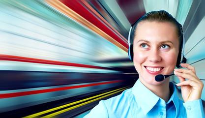 Businesswomen and train on speed in railway station