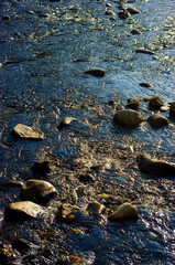 Running water and stone at a river