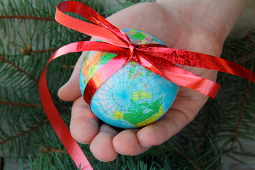"""Globe in hand - the concept of """"I'll give you the whole world"""""""