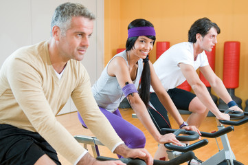 Spinning excercise group at gym