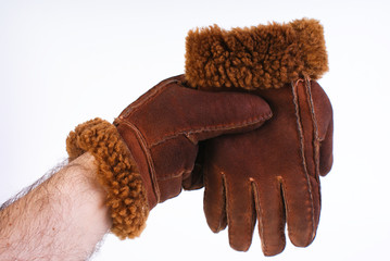 Brown leather gloves isolated on white background