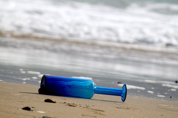 Blue Bottle on Sea Shore