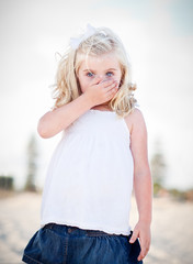 Adorable Blue Eyed Girl Covering Her Mouth