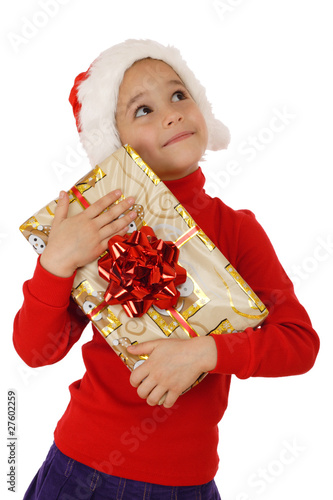 Dreaming little girl with yellow Christmas gift box