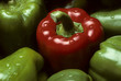 Single red Bell pepper among green peppers
