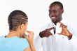 friendly african pharmacist helping sick customer
