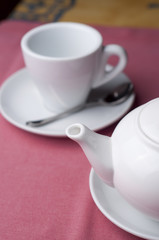 serving teaspot with empty cup, sugar and teaspoon in the cafe
