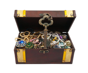 Treasure chest with key over white