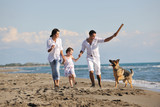 Fototapety happy family playing with dog on beach