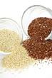 Red and white quinoa grain in bowls