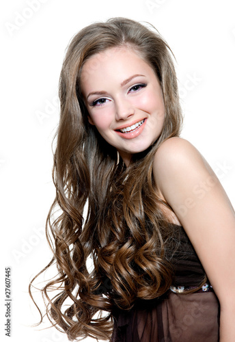 Beautiful happy young girl with  long curly hairs