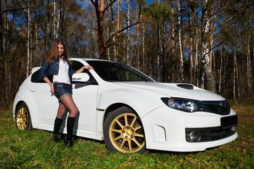 Beautiful girl and stylish white sports car