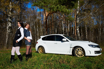 Two girls friend and stylish white sports car