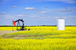 canvas print picture - Nodding oil pump in prairies