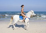 Girl rides on horse poster