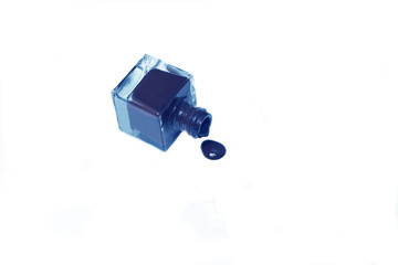 blue nail polish bottle with splatters isolated on white backgro