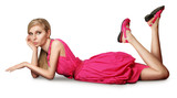 blonde in pink dress lies on a floor