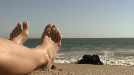 Legs on resort beach - HD