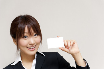 a portrait of young business woman have a card