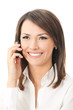 Happy smiling businesswoman with cell phone, isolated